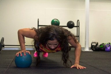 Single arm ball push ups